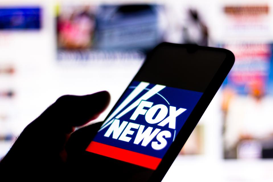 In this photo illustration the Fox News Channel logo seen...