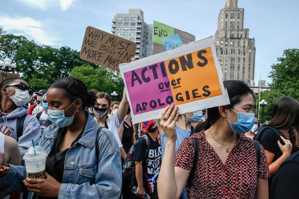 Black Lives Matter Demonstrators hold placards