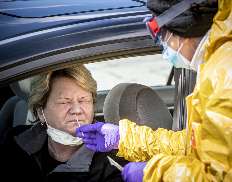 Woman in car is tested for coronavirus on Long Island