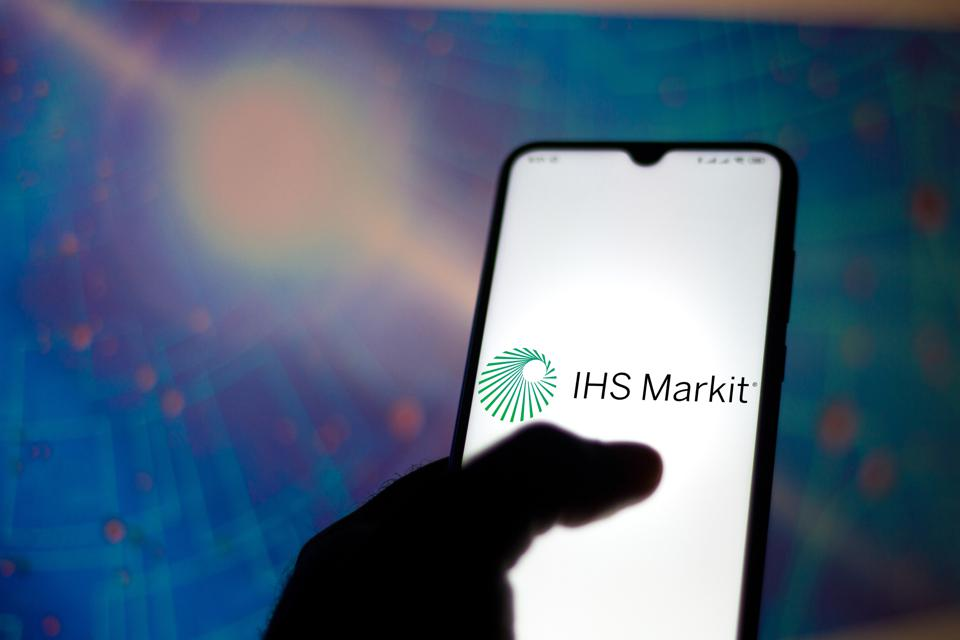 In this photo illustration the IHS Markit logo seen...