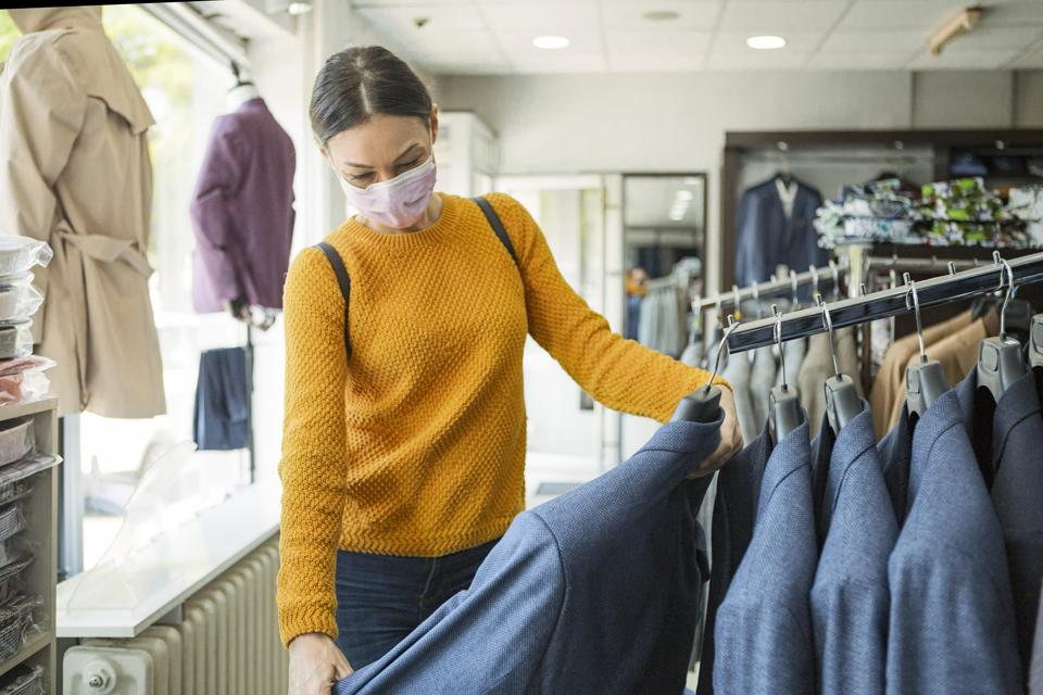 Young woman shopping at the time of virus wearing protective mask