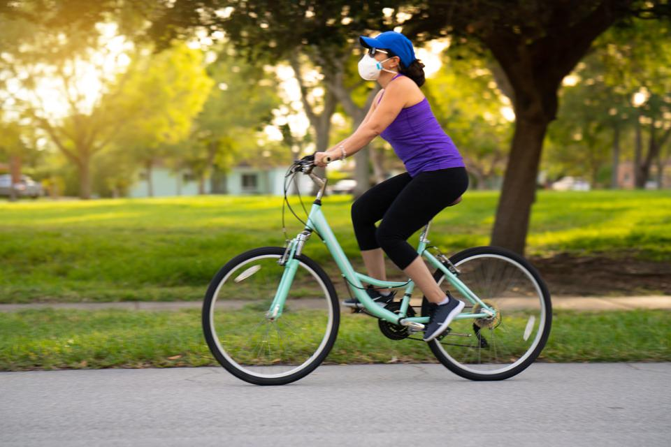 Woman cycling in mask