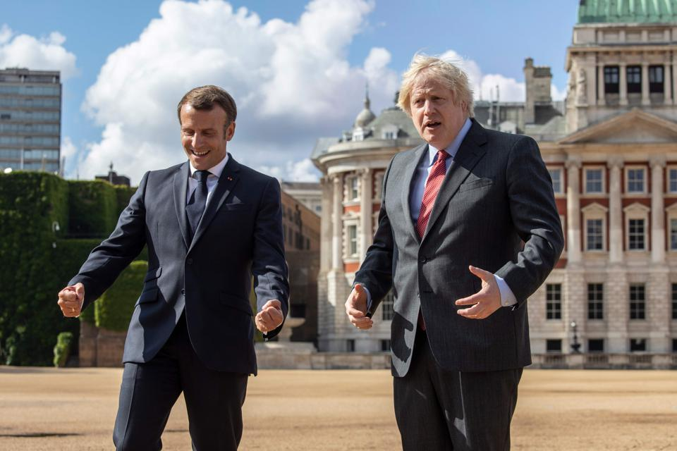 Britain's Prime Minister Boris Johnson (R) and French President Emmanuel Macron (L) on Horse Guards Parade in London on June 18, 2020
