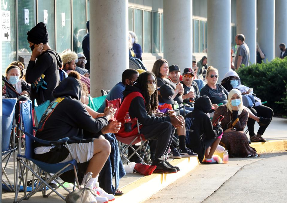 People Wait In Line To File For Unemployment Benefits In Frankfort, Kentucky