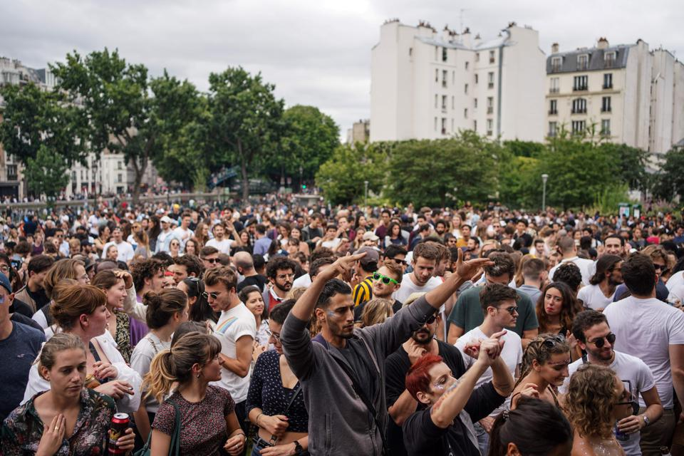 Hundreds of people celebrating at music festival in Paris