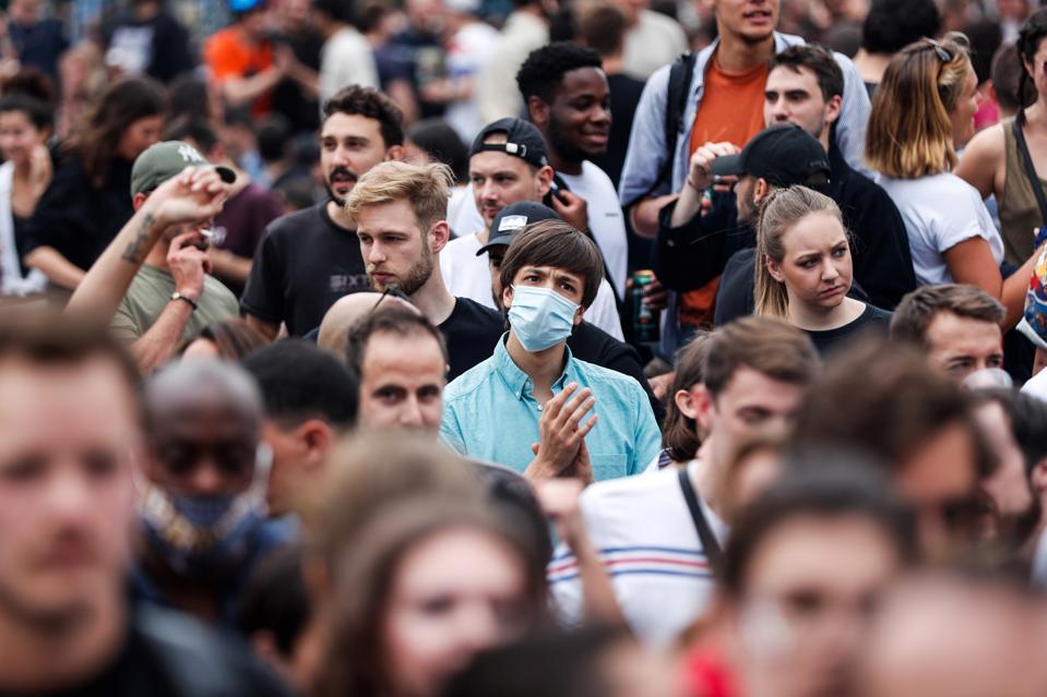 Parisians celebrating at a Music Festival