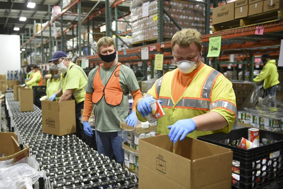 Penn DOT Sent Workers to the Helping Harvest Food Bank to Help Distribute Food in Reading PA During the Coronavirus Pandemic