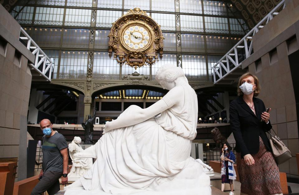 Visitors wearing protective face masks visit the Musee d'Orsay in Paris, France, June 23, 2020.