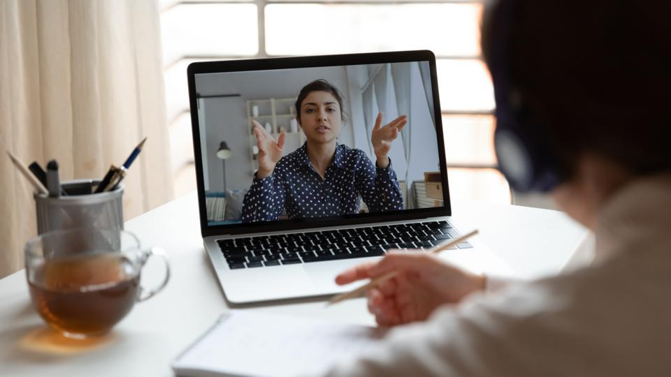 Male employee talk on video call with female colleague