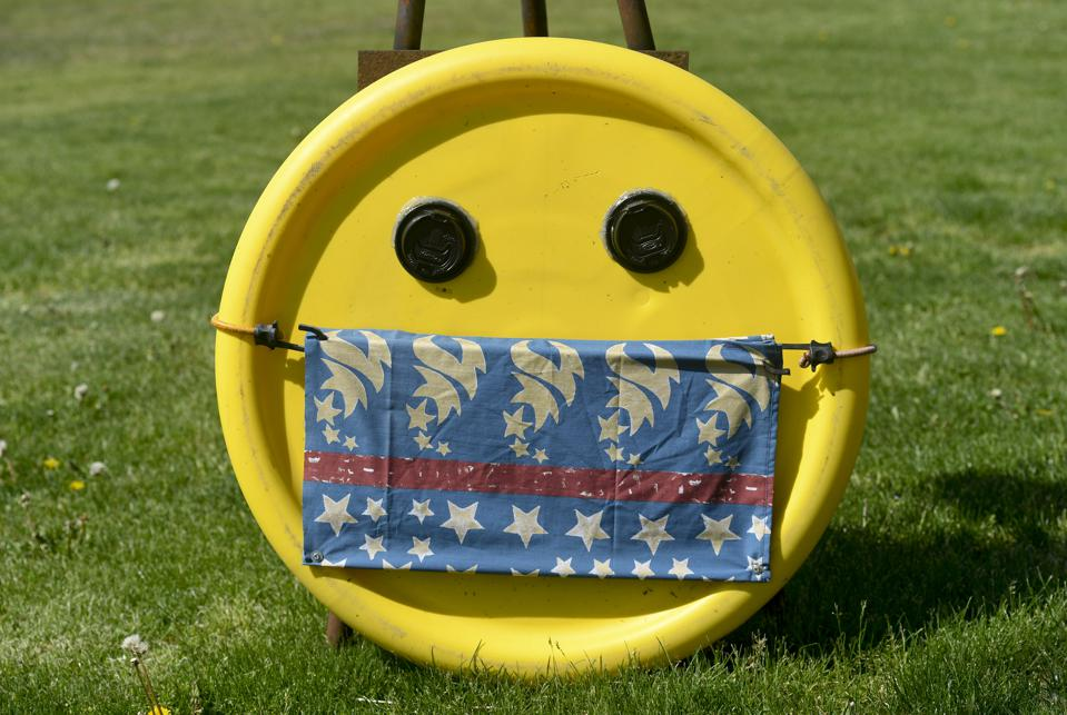 Smiley Face With Cloth Face Mask During Coronavirus Outbreak