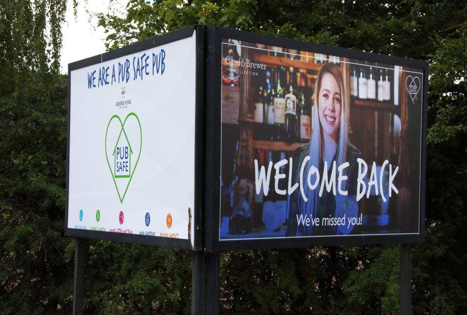 A Welcome Back, Pub Safe scheme sign is displayed in the entrance of one of the pubs in the scheme across the U.K. as pubs reopen after lockdown