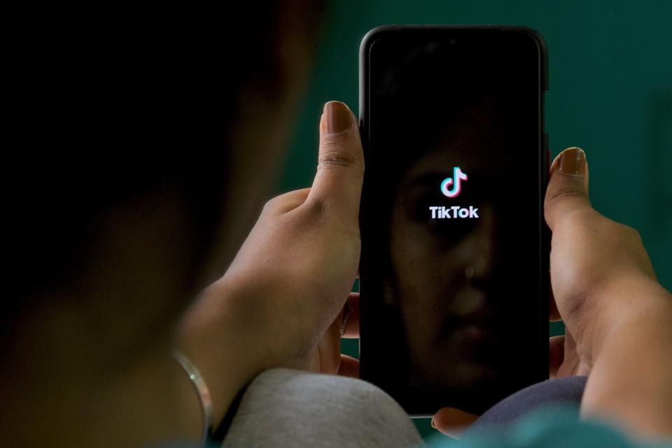 An Indian mobile user browses through TikTok app on a smartphone in Bangalore.