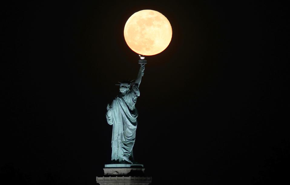 Super Flower Moon Rises Behind the Statue of Liberty in New York City
