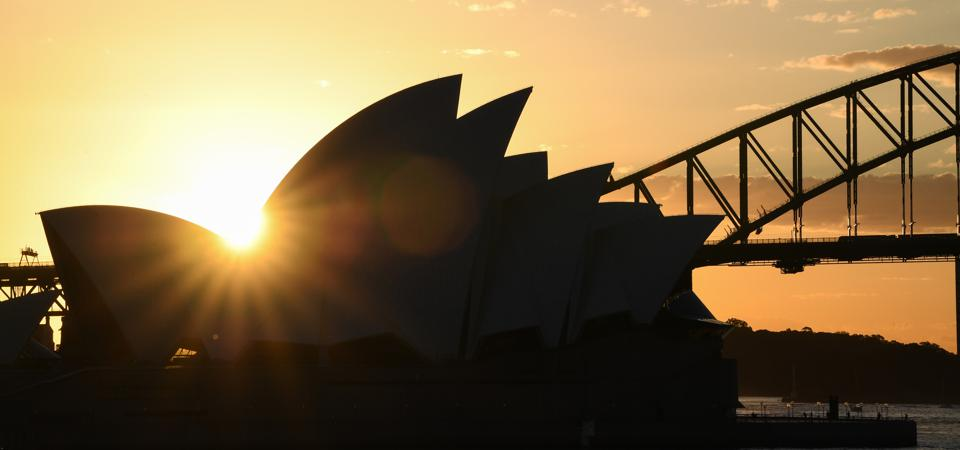 The iconic Sydney Opera House and Harbour Bridge at sunset on May 08, 2020 in Sydney, Australia. (Photo by James D. Morgan/Getty Images)