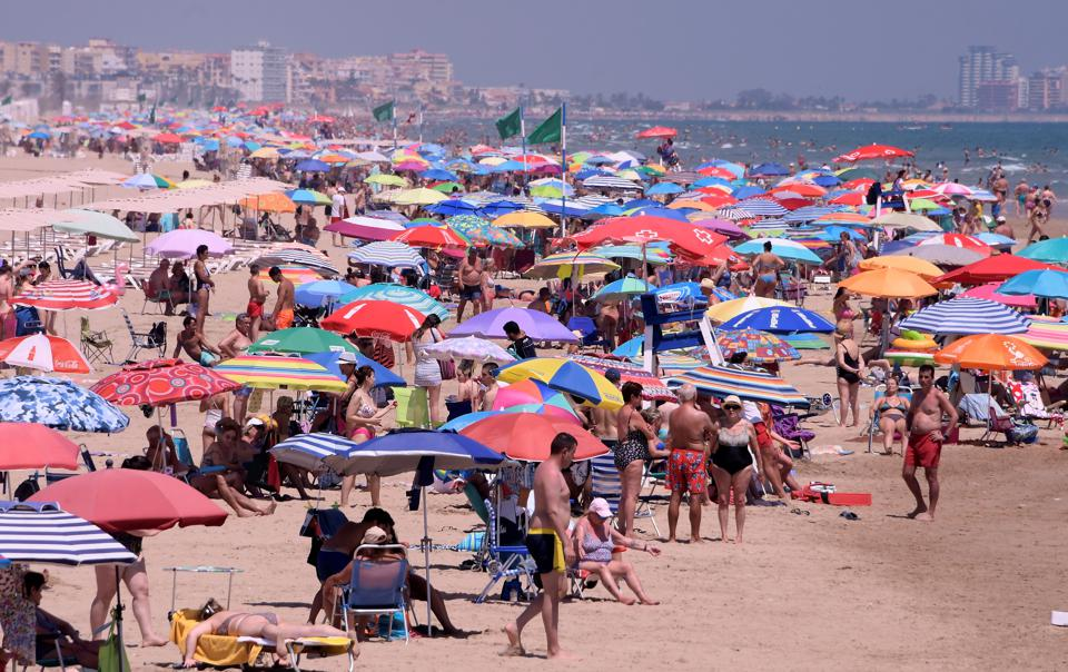 Tourists flock to Spain beaches as EU borders open to safe list of travel countries not US