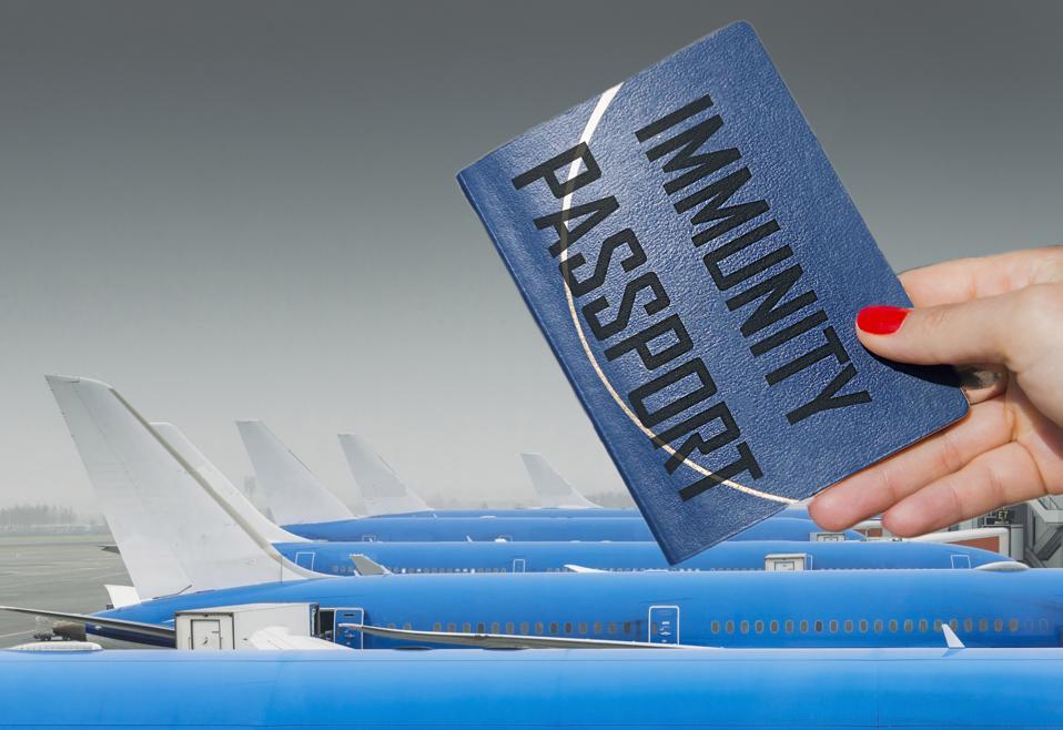 Person holding immunity passport Coronavirus Covid-19 at airport travel concept