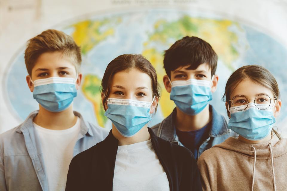 Group of high school students at school, wearing face masks.