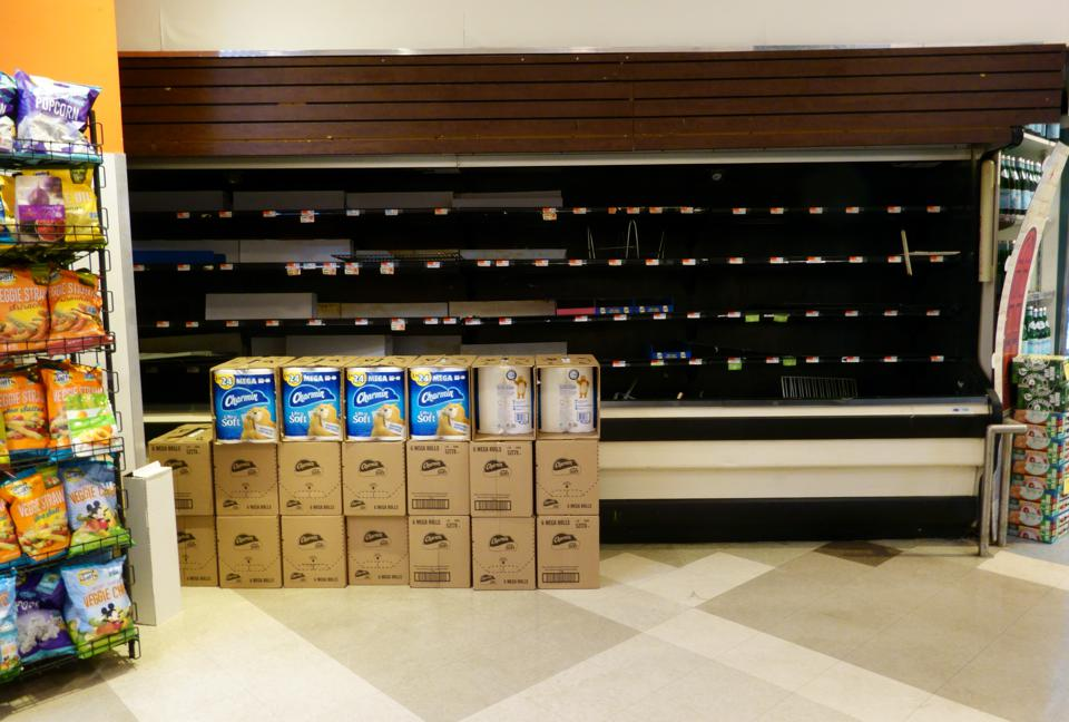 Empty shelves in refrigerated chicken aisle of grocery store in Manhattan, NY