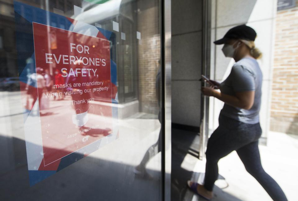 Woman enters shop wearing mask in CANADA-TORONTO as mask wearing inside become mandatory