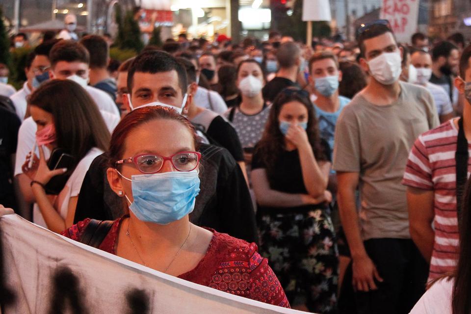 protestors in masks demonstrate against Covid-19 lockdown measures in Serbia