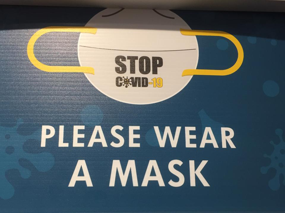 Wear a mask sign in Ontario Canada shop after COVID-19 Lockdown
