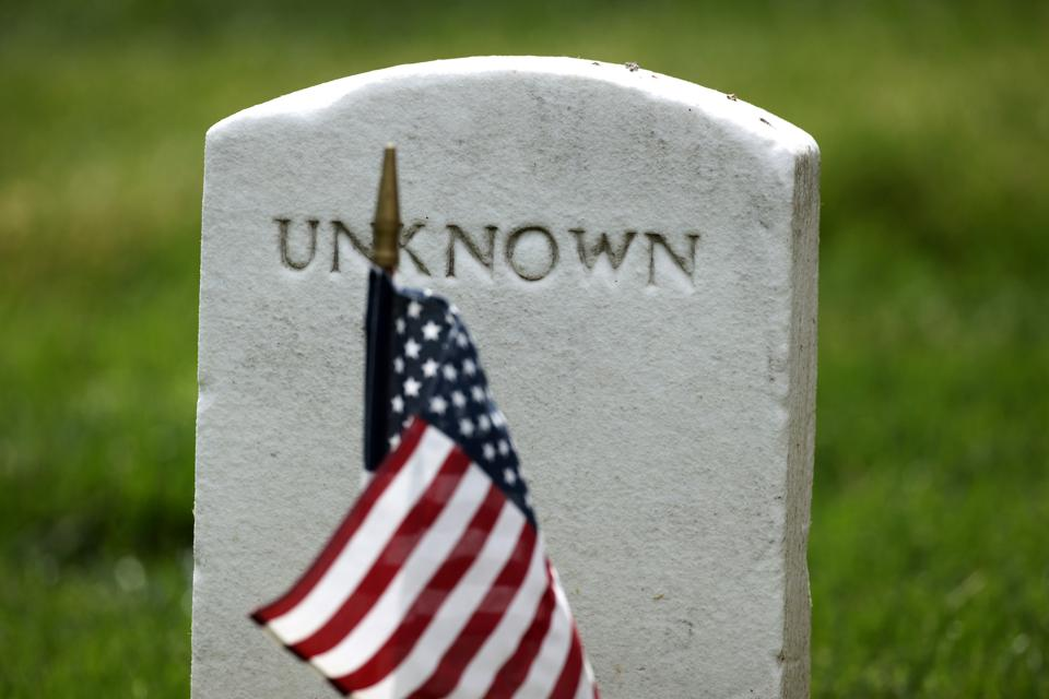 Arlington National Cemetery Holds Annual Flags-In To Honor Fallen For Memorial Day