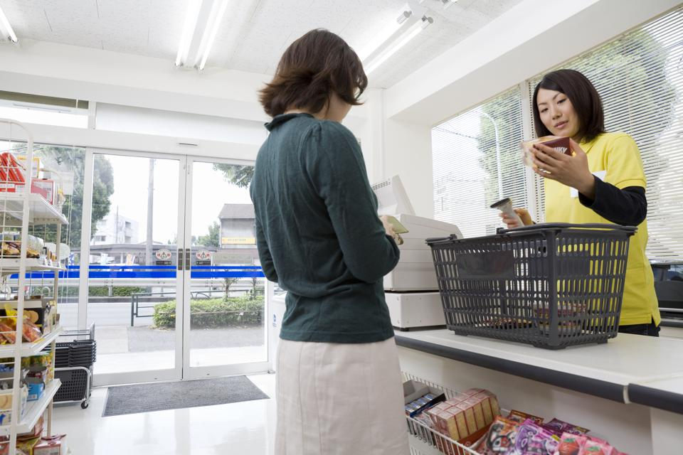 Clerk and customer at convenience store