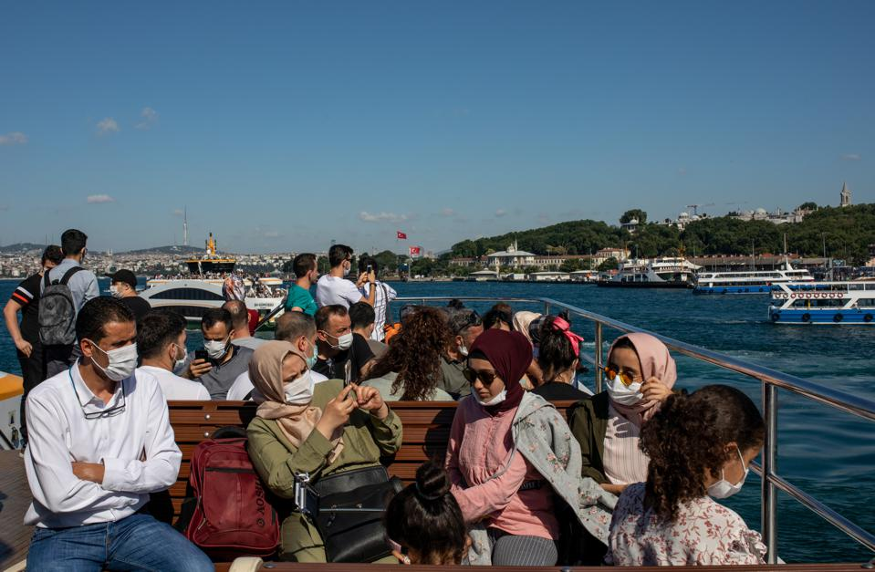 Tourists wearing masks on boat During COVID-19 Pandemic In Istanbul Turkey