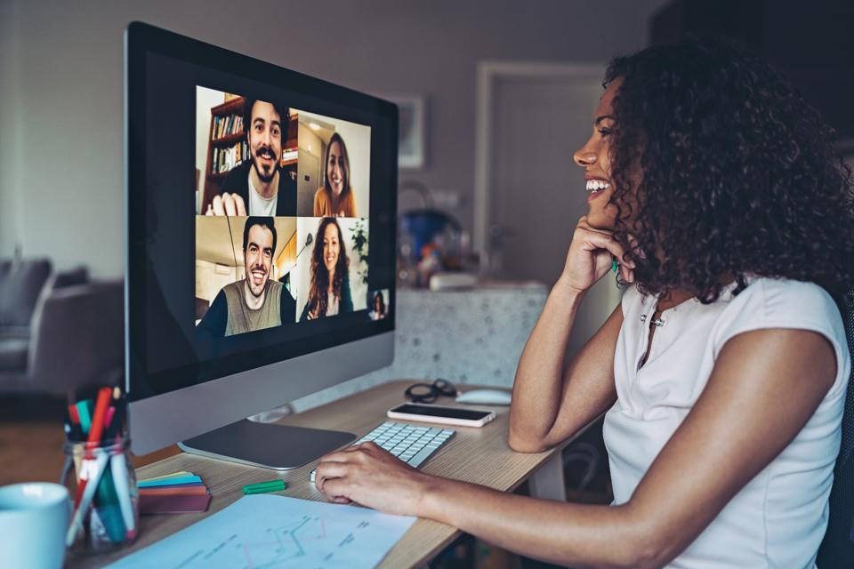 Colleagues talk online from their homes