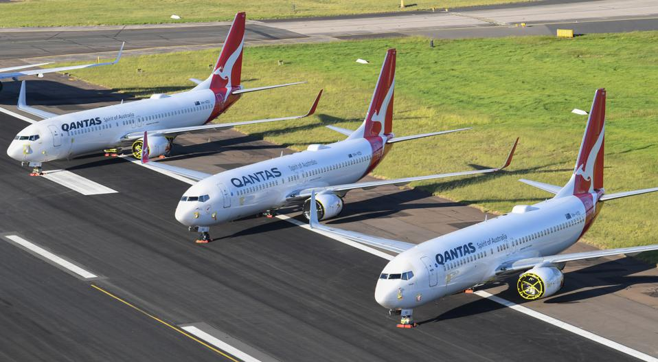 Qantas planes parked on the East-West runway at Sydney Airport due to Covid-19