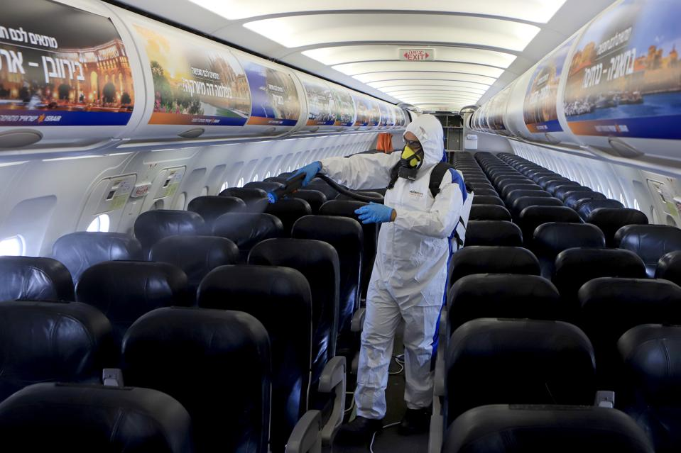 Airline maintenance crews disinfect aircraft around the world as travelers begin to think about flying again