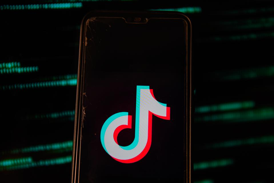 The logo for TikTok flashing on a smartphone.