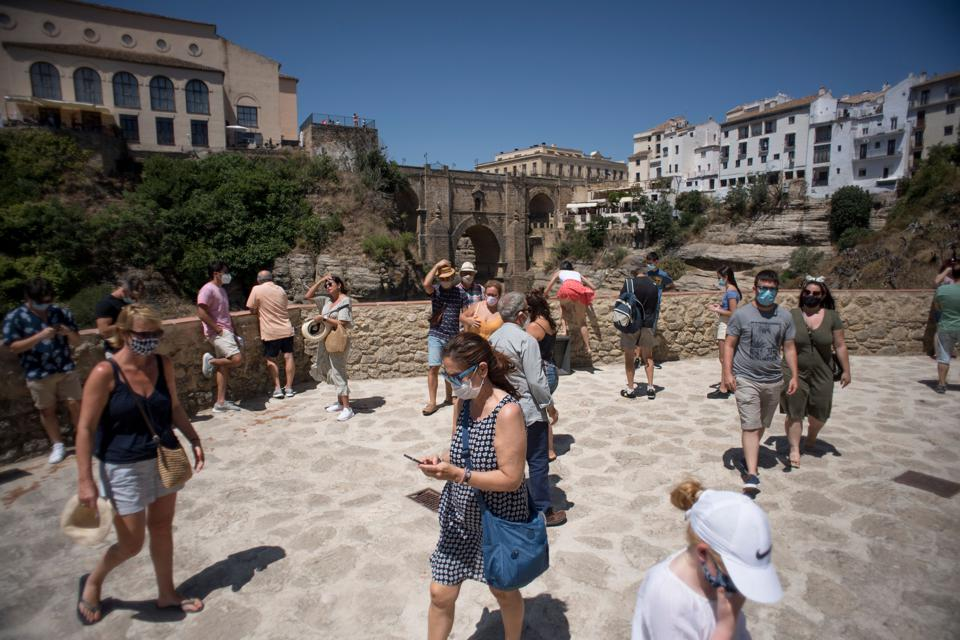 People in Ronda Andalusia Spain in face masks now mandatory for indoor and outdoor spaces