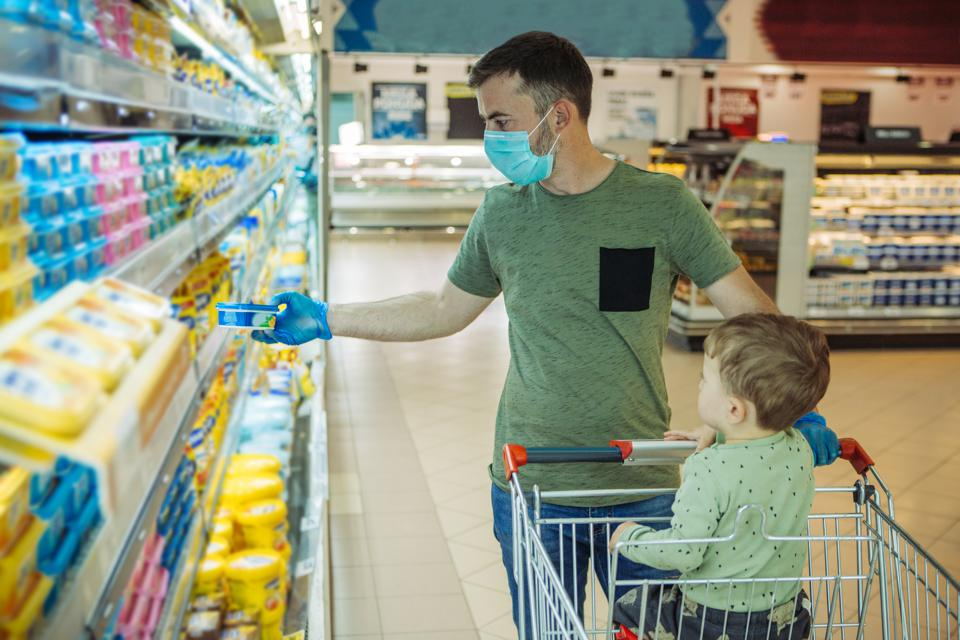 Father and son shopping during pandemic