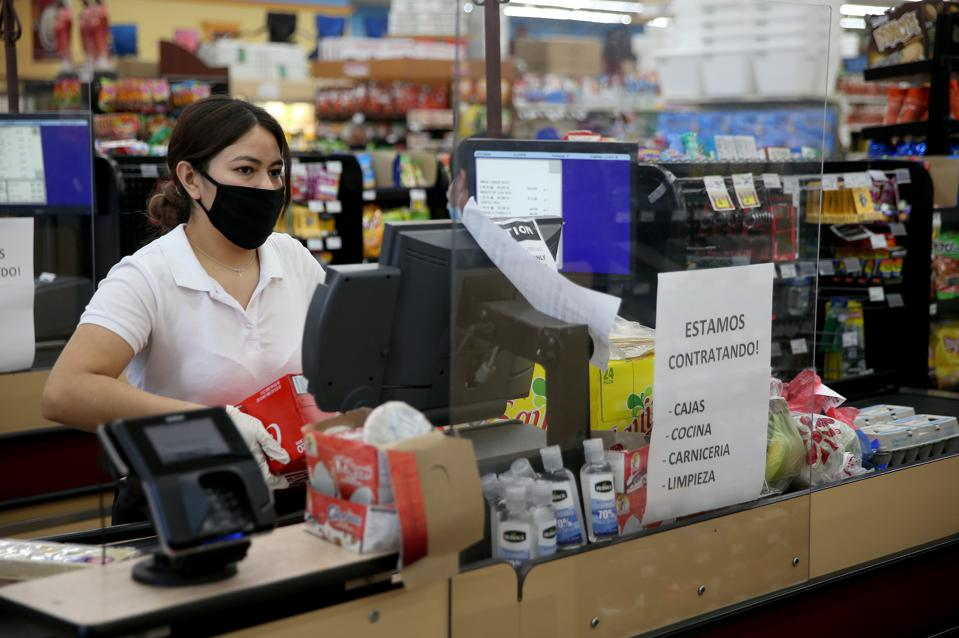 Supermarket cashier working in Oakland CA store during Covid-19