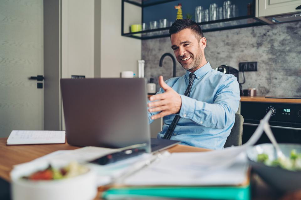 Businessman in a video conference from home