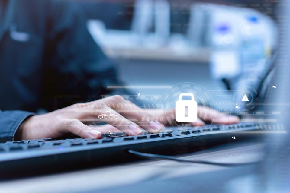 close up programmer man hand typing on keyboard to work about security system to protect and prevent malware ,virus, spam mail and hacker on internet network for futuristic cyber security concept