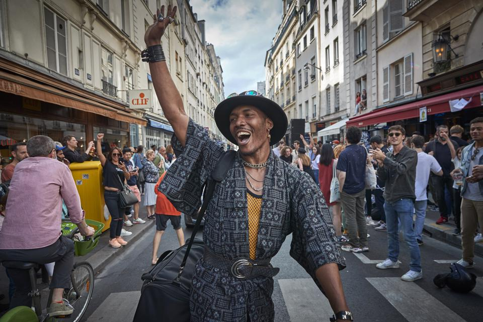 Parisians dancing in the streets.