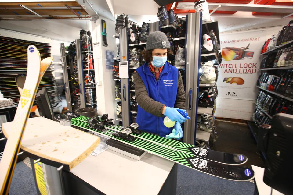 Fletcher McCormack of George's Ski Hire, cleans skis prior to them being hired out to the public, on June 23, 2020 at Mount Buller, Australia.