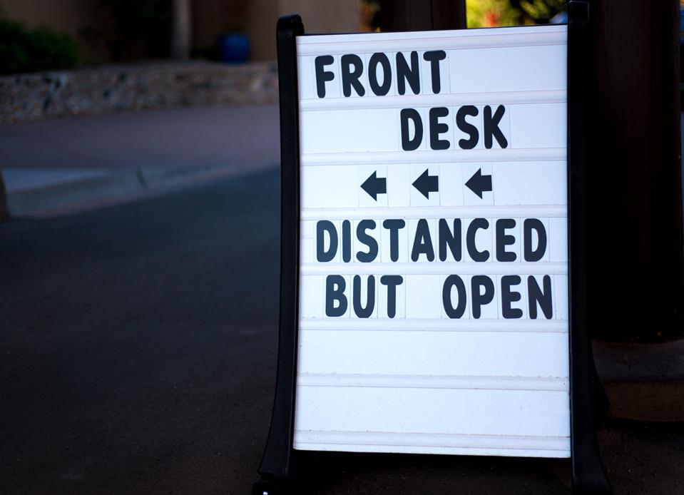 Pandemic Reopening Sign: FRONT DESK, DISTANCED BUT OPEN
