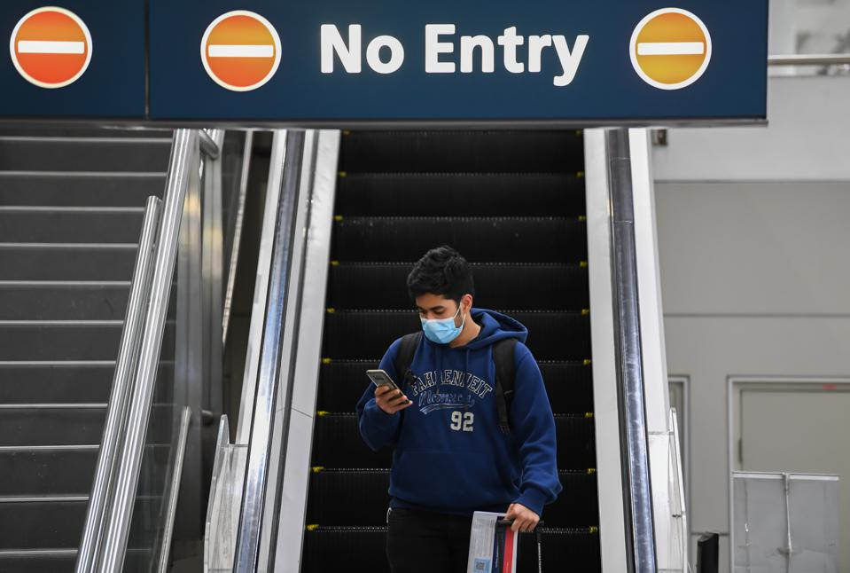 Man with face mask at Sydney airport