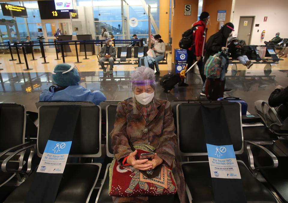 Passenger wearing mask at airport in Peru as flights domestic tourism begin