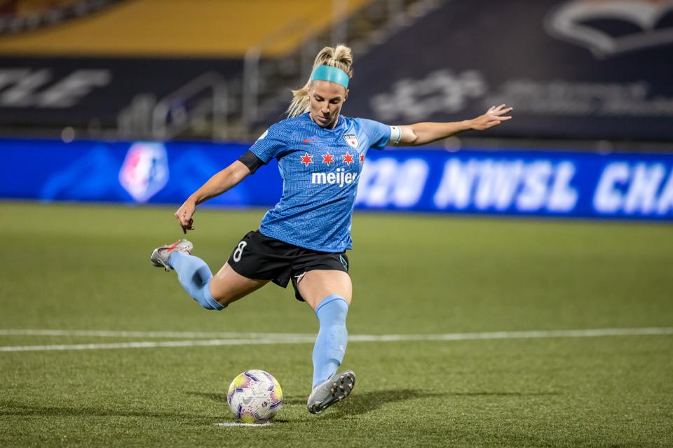 Julie Ertz of Chicago Red Stars takes a penalty kick during a match against OL Reign during the NWSL Challenge Cup (Photo by Bryan Byerly/ISI Photos/Getty Images). GETTY IMAGES