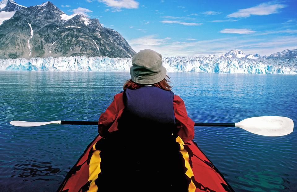 Kayaking near a tidewater glacier in East Greenland.