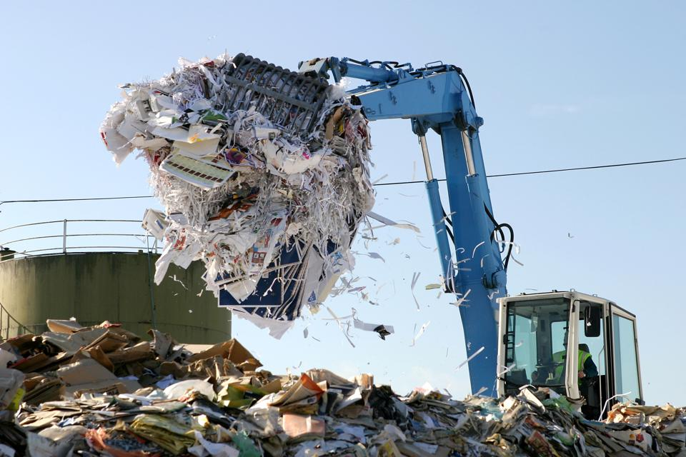 Paper being recycled at waste collection plant
