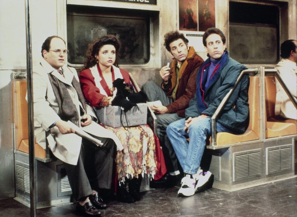 SeinfeldJason Alexander as George Costanza, Julia Louis-Dreyfus as Elaine Benes, Michael Richards as Cosmo Kramer, Jerry Seinfeld as Jerry Seinfeld.