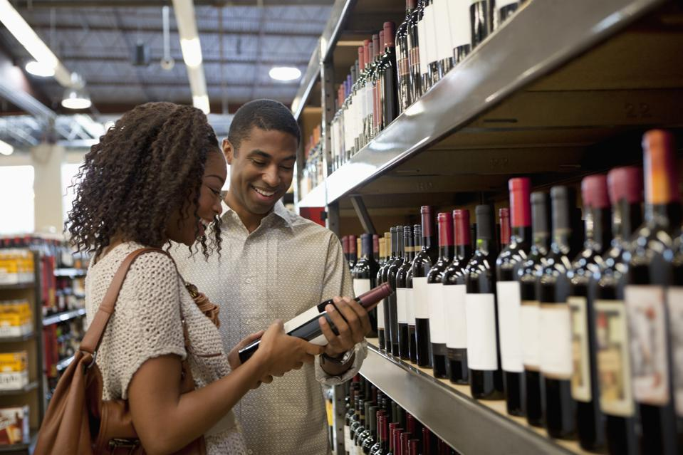 Couple shopping for wine together