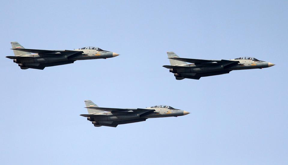 Iran's F-14 fighter jets fly during the