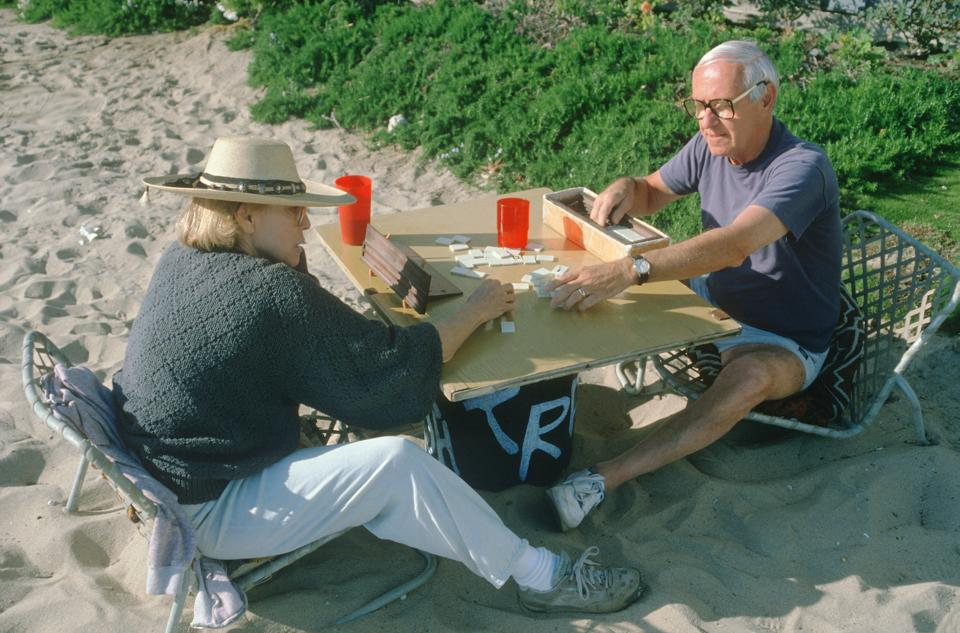 A retired couple playing a board game at Venice Beach, CA