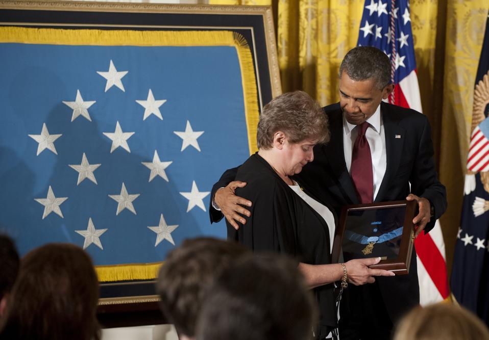 US President Barack Obama presents Rose